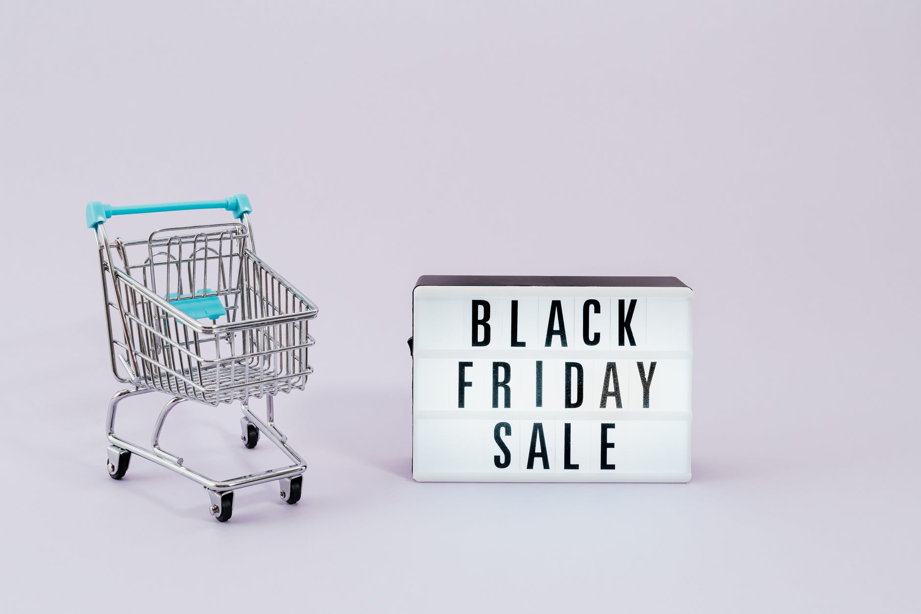 shopping cart next to a black friday sale sign